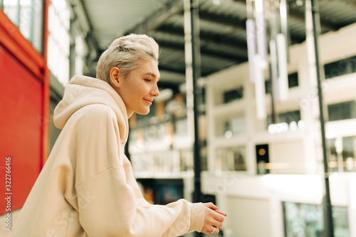 Blond young woman with short hair indoors #322766416