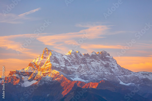 Fotografie, Obraz Sinrise or sunset panoramic view of the Dents du Midi in the Swiss Alps, canton