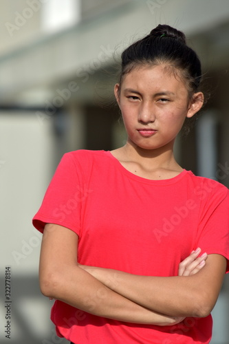 Photo A Stubborn Youthful Female Youngster