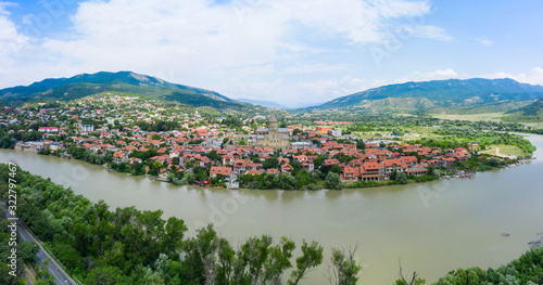 Fototapeta Panoramic view of Mtskheta, The Old Town Lies At The Confluence Of The Rivers Mtkvari And Aragvi. Svetitskhoveli Cathedral, Ancient Georgian Orthodox Church, Unesco Heritage In The Center. obraz na płótnie
