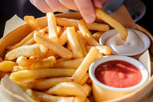 Appetizing French Fries With Sauce In A Wooden Dish, In Natural Light From The Window.