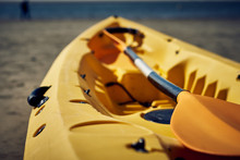 Yellow Kayak On The Seashore