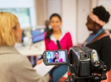 Video Camera Filming Female Co...
