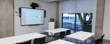 Empty Classroom With Projectio...