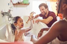 Parents Giving Daughter Bubble Bath