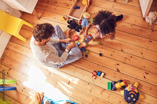 Father and daughter playing with wood blocks - 322811878