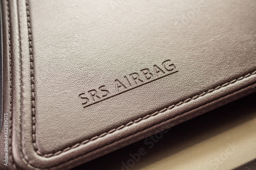 airbag safety sign on brown leather texture in modern car Canvas Print