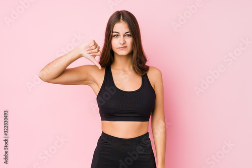 Young caucasian fitness woman doing sport isolated showing a dislike gesture, thumbs down Tablou Canvas