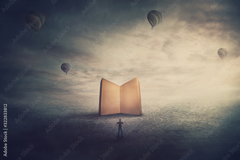 Fototapeta Surreal scene, imaginary world, tiny man stands in front of a giant opened book with empty blank pages. Education concept, the magic and fantasy of a story teller. Knowledge and wisdom symbol.