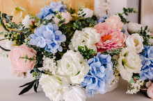 Big Bouquet Of Fresh Flowers, Pink, Blue Hydrangeas, White Roses And Greenery In Vase. Wedding Flowers, Bridal Bouquet Closeup. Home Decor On Table, Vintage Style. Decoration Objects.