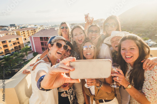 Fotomural Group of happy and cheerful young women have fun in party together outdoor takin