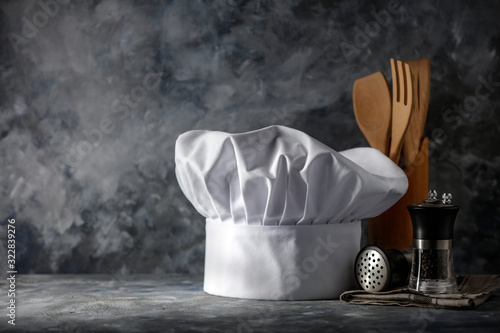 White cook hat on desk and kitchen interior Canvas-taulu
