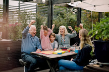 Cheerful Family Playing Board ...