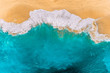 canvas print picture - Aerial view of turquoise ocean waves in Kelingking beach, Nusa penida Island in Bali, Indonesia. Beautiful sandy beach with turquoise sea. Splashing ocean waves reach sandy beach. Beaches of Indonesia