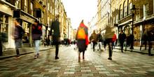 Motion Blurred People On Shopp...