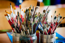 A Lot Dirty Artist Paint Brushes In A Bucket
