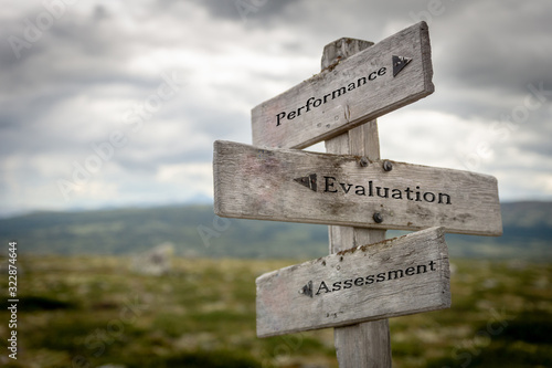 Performance, evaluation and assessment word, text and quote on wooden sign post outdoors in nature Canvas Print