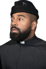 Portrait Of A Male Priest Looking Off Camera, Dallas, Texas, USA
