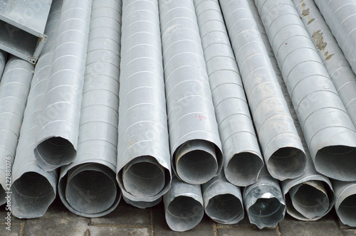 Large iron metal tin corrugated ventilation pipes of large diameter for the indu Canvas Print