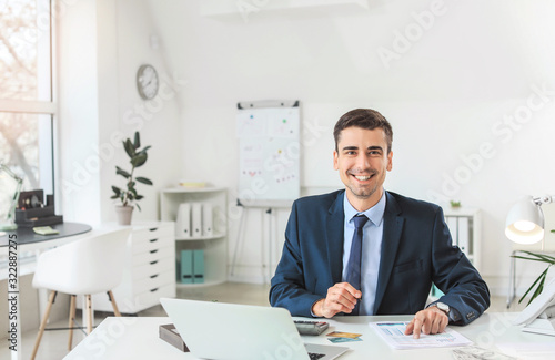 Male bank manager working in office Canvas Print