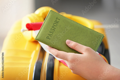 Fototapeta Woman with passport, Canadian flag and luggage, closeup