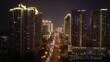 flight over qingdao city downtown night time illuminating show traffic street aerial panorama 4k china