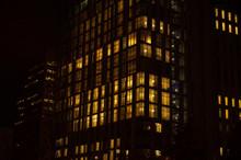 Night Skyscraper Closeup, Glowing Window. Night Work