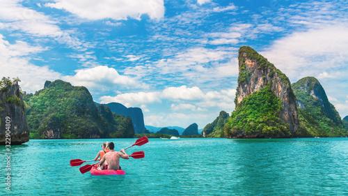 Beautiful nature scenic landscape island with activity couple traveler kayaking Phang-Nga bay, Tourist adventure travel Phuket Thailand, Tourism destination place Asia, Summer holiday vacation trip