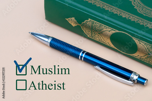 On a piece of paper are written Muslim and Atheist with a choice Canvas Print