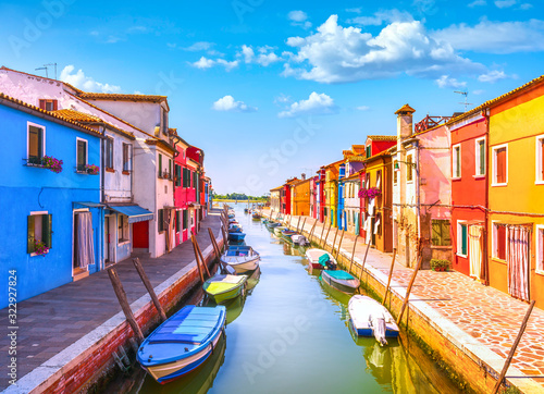 Fototapeta Venice landmark, Burano island canal, colorful houses and boats, Italy obraz