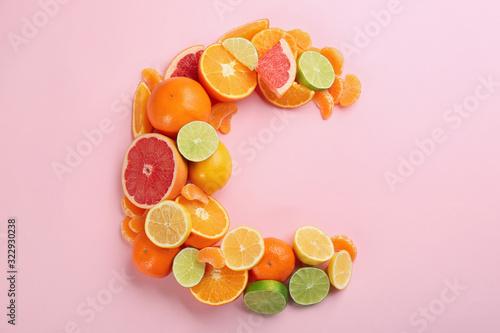 Obraz na plátně Letter C made with citrus fruits on pink background as vitamin representation, f