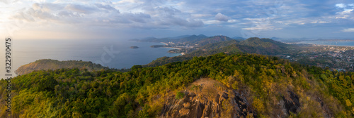 Aerial panorama of the island of Phuket during sunset Fotobehang