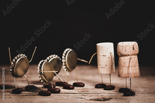Crown cork, wine and champagne cork miniature figures with a handshake, concept Canvas Print