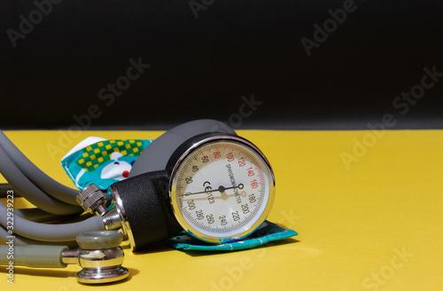 Pediatrics sphygmomanometer on yellow with black background, children and newborn blood pressure contrtext space Canvas Print