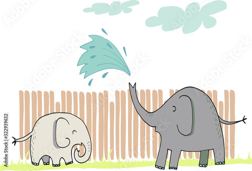 Super cute mommy and baby elephants playing, splashing water, having fun Wallpaper Mural