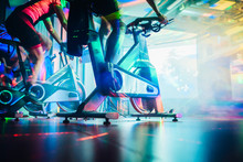 Spinning Class, Group Activity On Stationary Bike. Team Cardio Excercise On Bicycle.