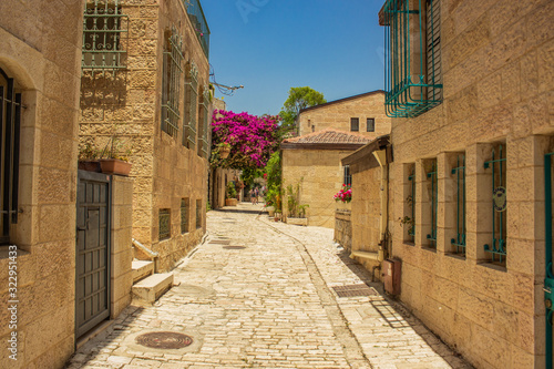 Fototapety, obrazy: Jerusalem Israeli capital ancient city street stone paved walk side alley between living building in summer bright sunny day time