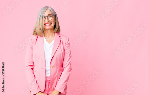 middle age cool woman looking happy and goofy with a broad, fun, loony smile and Canvas Print