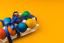 Colorful Easter Eggs On  Yello...