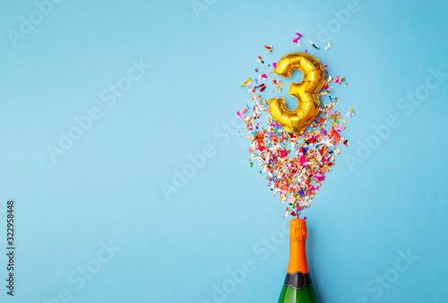 Obraz 3rd anniversary champagne bottle balloon pop - fototapety do salonu