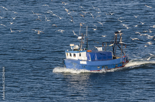 Obraz FISHING BOAT - Small boat on the sea fishing ground - fototapety do salonu