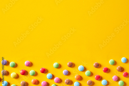 Colorful candy border with sugar-coated chocolate Wallpaper Mural