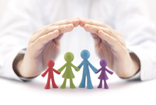 Family Insurance Concept With Colorful Family Figurines Covered By Hands