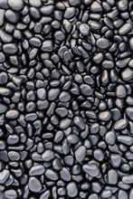 Texture Of Black Painted Pebbles