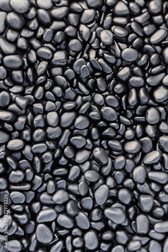 Photo texture of black painted pebbles