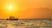 Silhouette Of Speed Boat In The Ocean At Sunset. Oating At Sunset In Atlantic Ocean, South Africa