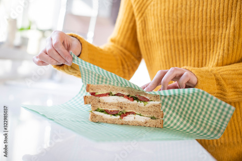 Close Up Of Woman Wrapping Sandwich In Reusable Environmentally Friendly Beeswax Wallpaper Mural