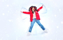 Snow Angel Concept. Happy Woma...