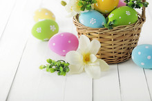 Easter Eggs In Basket On The Table