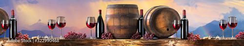 red wine on an old wood with a landscape background Wallpaper Mural